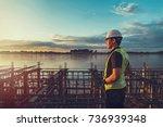 engineer working on building... | Shutterstock . vector #736939348