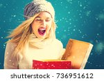 happy young woman opening a... | Shutterstock . vector #736951612