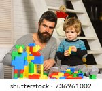 dad and kid with toys on... | Shutterstock . vector #736961002