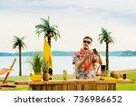 handsome bartender standing... | Shutterstock . vector #736986652