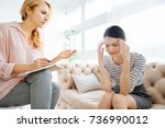 depressed unhappy woman holding ... | Shutterstock . vector #736990012