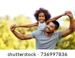 portrait of young father... | Shutterstock . vector #736997836