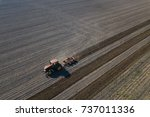 farmer in tractor preparing... | Shutterstock . vector #737011336