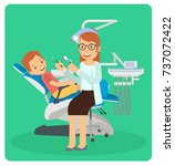 a woman dentist examining a... | Shutterstock .eps vector #737072422