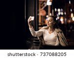 girl with phone at night | Shutterstock . vector #737088205