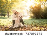 girl with dog | Shutterstock . vector #737091976
