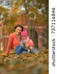 mother and daughter outdoors | Shutterstock . vector #737116846