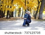 young mother and little son in... | Shutterstock . vector #737125735