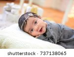 funny newborn baby looks at the ... | Shutterstock . vector #737138065