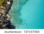 Beautiful beach, coast and bay with crystal clear sea water seen from above - stock photo