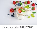 fresh yogurt with berries in... | Shutterstock . vector #737157706