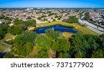 low view of greenbelt   pond  ... | Shutterstock . vector #737177902