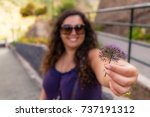 girl holding a flower with a... | Shutterstock . vector #737191312