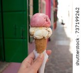 Small photo of Gelato. Italian ice cream in a waffle cone, to hold