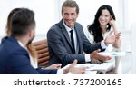 employees discuss work issues | Shutterstock . vector #737200165