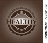 healthy badge with wooden... | Shutterstock .eps vector #737234212