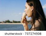 dear lady on a walk eating... | Shutterstock . vector #737274508