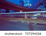 traffic trails in downtown hong ... | Shutterstock . vector #737294206