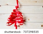 ribbon christmas tree on wood... | Shutterstock . vector #737298535