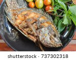 fried fish in plate | Shutterstock . vector #737302318