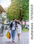 asian couple go shopping... | Shutterstock . vector #737324215