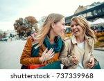 happy friends shopping. two... | Shutterstock . vector #737339968