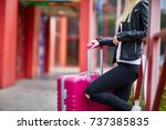 a girl is standing by the... | Shutterstock . vector #737385835