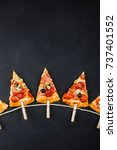slices of pizza in the form of... | Shutterstock . vector #737401552