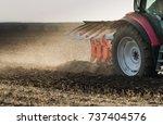 tractor plowing fields  ...   Shutterstock . vector #737404576