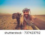 happy man taking crazy selfie... | Shutterstock . vector #737423752