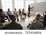 man presenting at a seminar | Shutterstock . vector #737424856