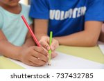 young male volunteer drawing...   Shutterstock . vector #737432785