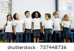 happy kids at elementary school | Shutterstock . vector #737448736