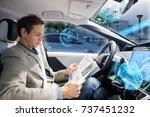 caucasian driver reading... | Shutterstock . vector #737451232