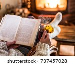 hot mulled wine and book in... | Shutterstock . vector #737457028