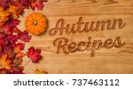 a wooden background with autumn ... | Shutterstock . vector #737463112