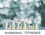 double exposure of stacks of... | Shutterstock . vector #737465635