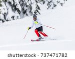 man skier with helmet and gopro ... | Shutterstock . vector #737471782