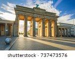 the brandenburg gate in berlin... | Shutterstock . vector #737473576