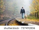 old railway station in fog.... | Shutterstock . vector #737492836