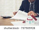 businessman as a property agent ... | Shutterstock . vector #737505928