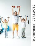 sportive father and sons... | Shutterstock . vector #737519752