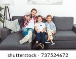 happy father with remote... | Shutterstock . vector #737524672
