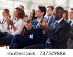 smiling audience applauding at... | Shutterstock . vector #737529886