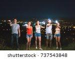 the friends hold firework... | Shutterstock . vector #737543848