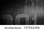 drops of water on a perforated... | Shutterstock . vector #737552398