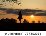 girl silhouette at sunset | Shutterstock . vector #737563396