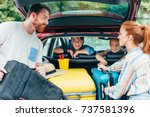 young parents packing luggage... | Shutterstock . vector #737581396