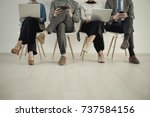 front view of four people using ... | Shutterstock . vector #737584156