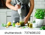 woman using hand blender to... | Shutterstock . vector #737608132